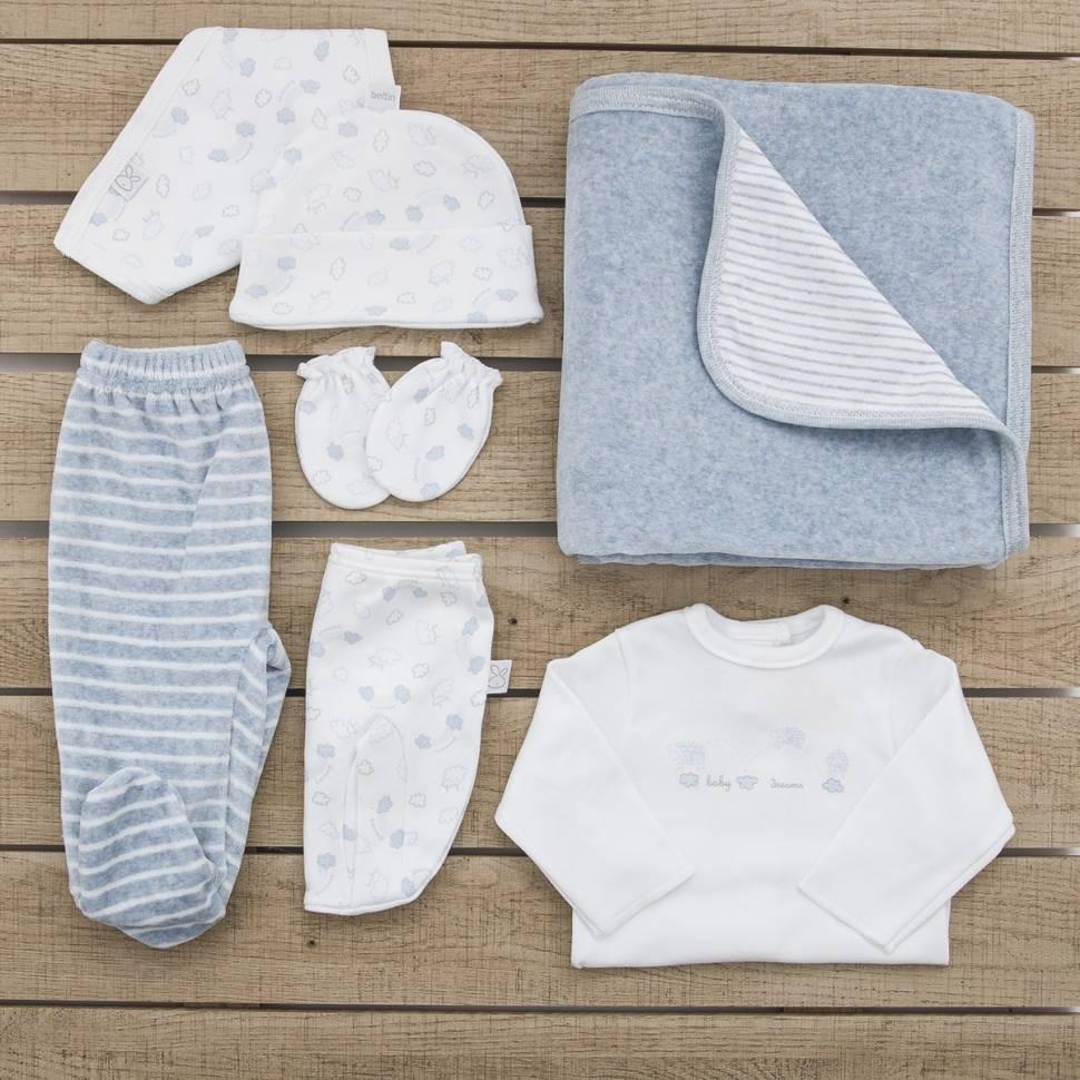 Pack recién nacido con primera puesta, gorrito, bandana, manoplas estampadas con ovejas de color azul y pantalón y arrullo