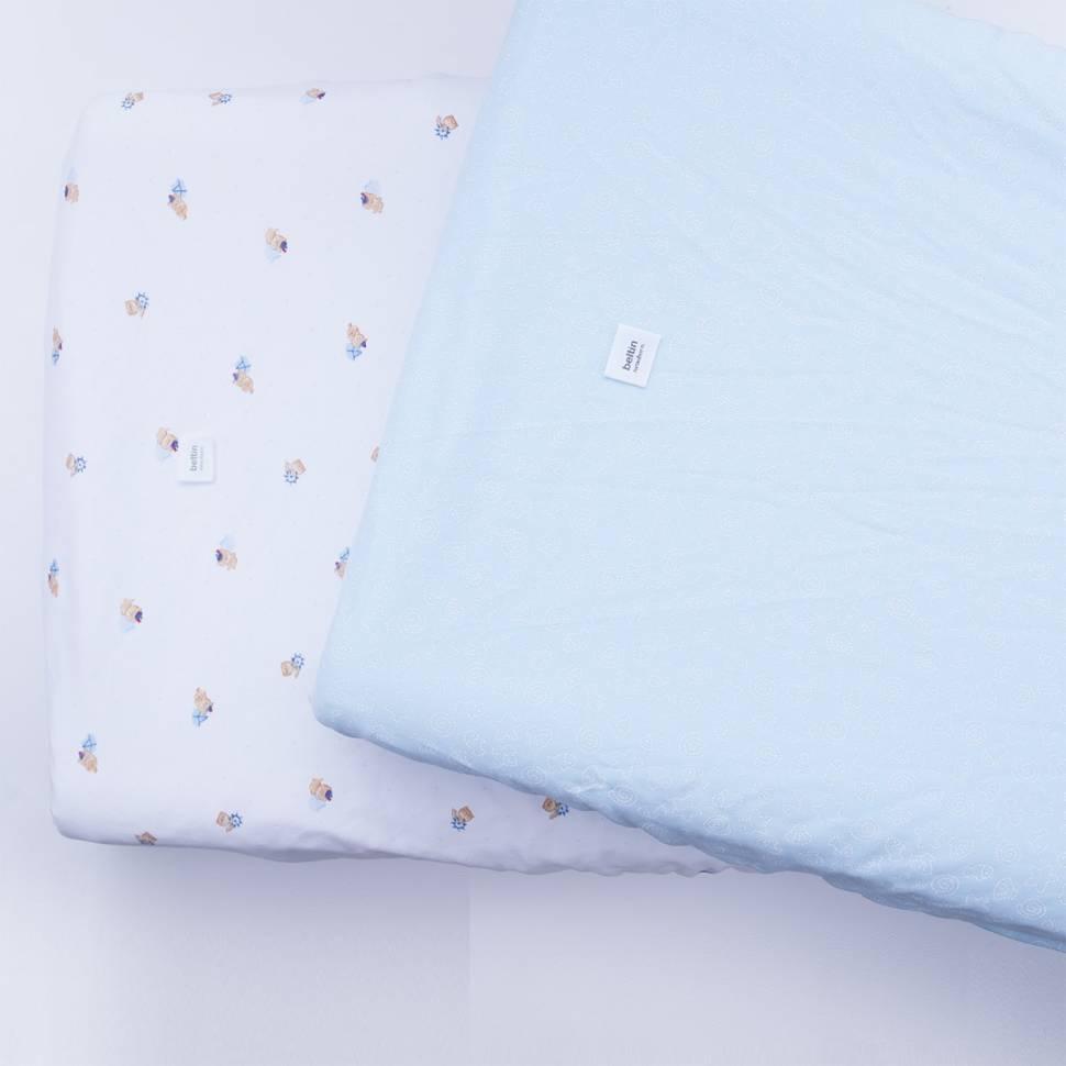 Pack de dos fundas de cambiador de medida universal confeccionada en 100% algodón. Modelos puppi y delfi azul.